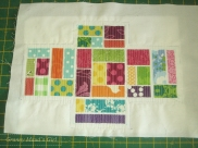 Ticker tape pincushion with matchstick quilting