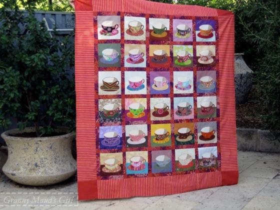 Kaffe Fassett teacup quilt pattern made by a group